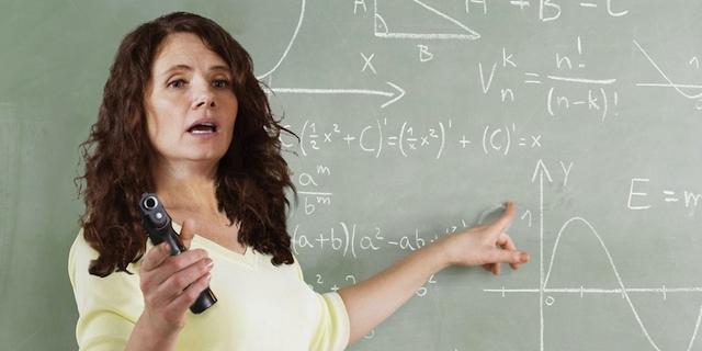 Teacher With Gun 2- OpinionatedMale.com
