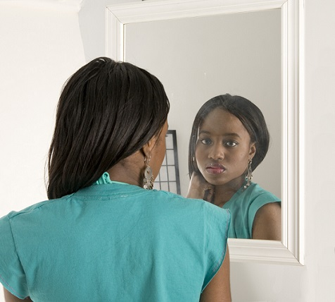 Black girl looking in the mirror for Mirror 7th girl