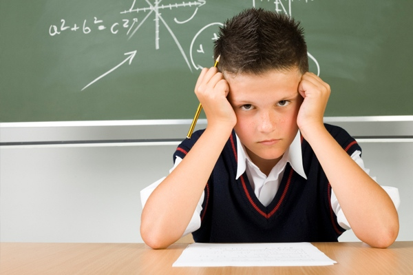 boy-taking-exam 1- OpinionatedMale.com