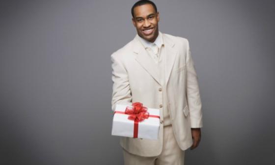 black-man-giving-gift - OpinionatedMale.com