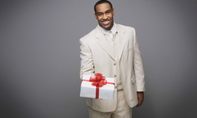 black-man-giving-gift - OpinionatedMale.com
