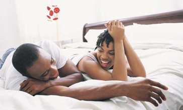 African American Couple in bed - Opinionatedmale.com