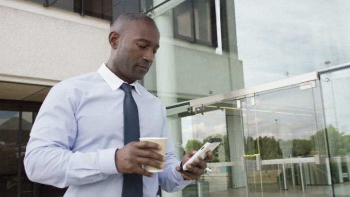 African American Man corporate on smart phone - OpinionatedMale.com